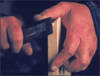 Woodworking craftsman paring with a chisel